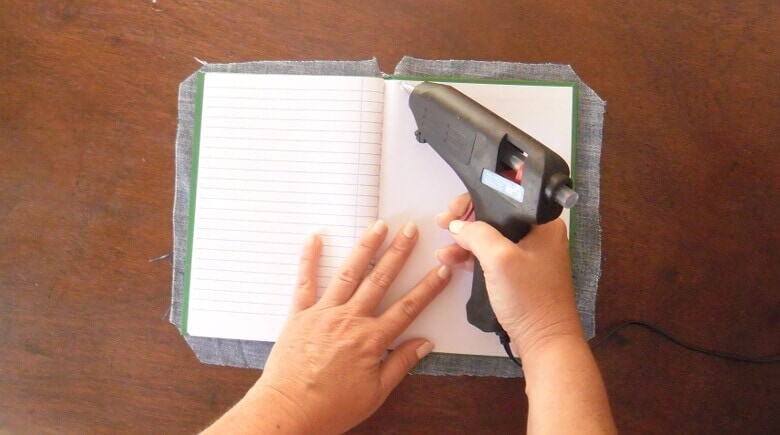 Glue the flaps to the notebook